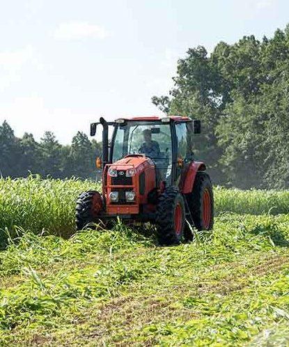 Tractor plowing in a field